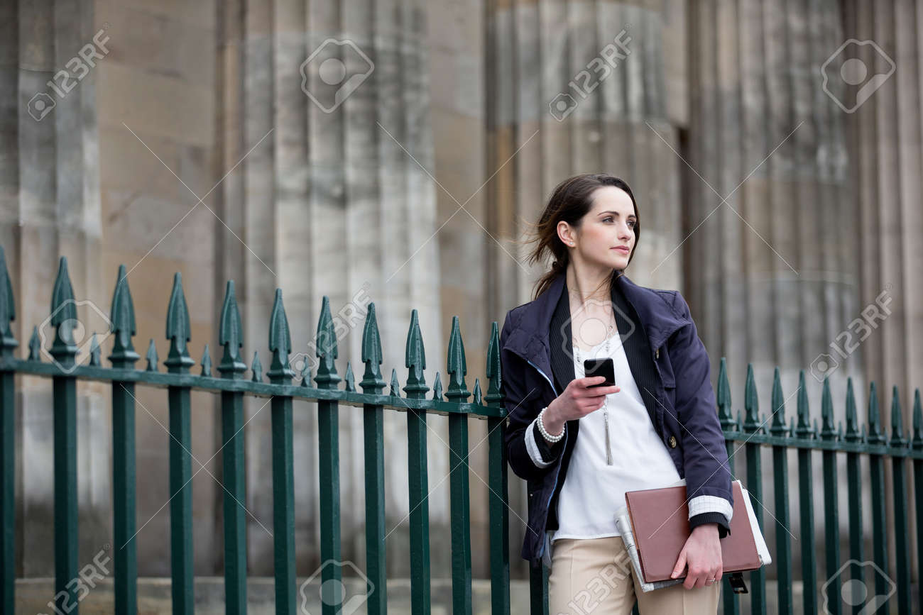 Modern Caucasian Business woman, talking on mobile smart phone outside. Beautiful young professional European businesswoman. Caucasian ethnicity. Stock Photo - 28417457