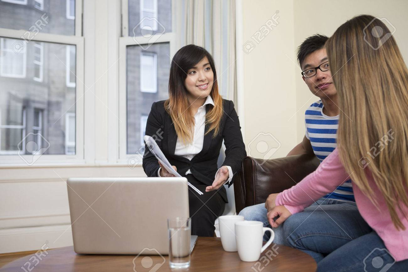 Asian couple meeting financial adviser for investment planning. Stock Photo - 33152166