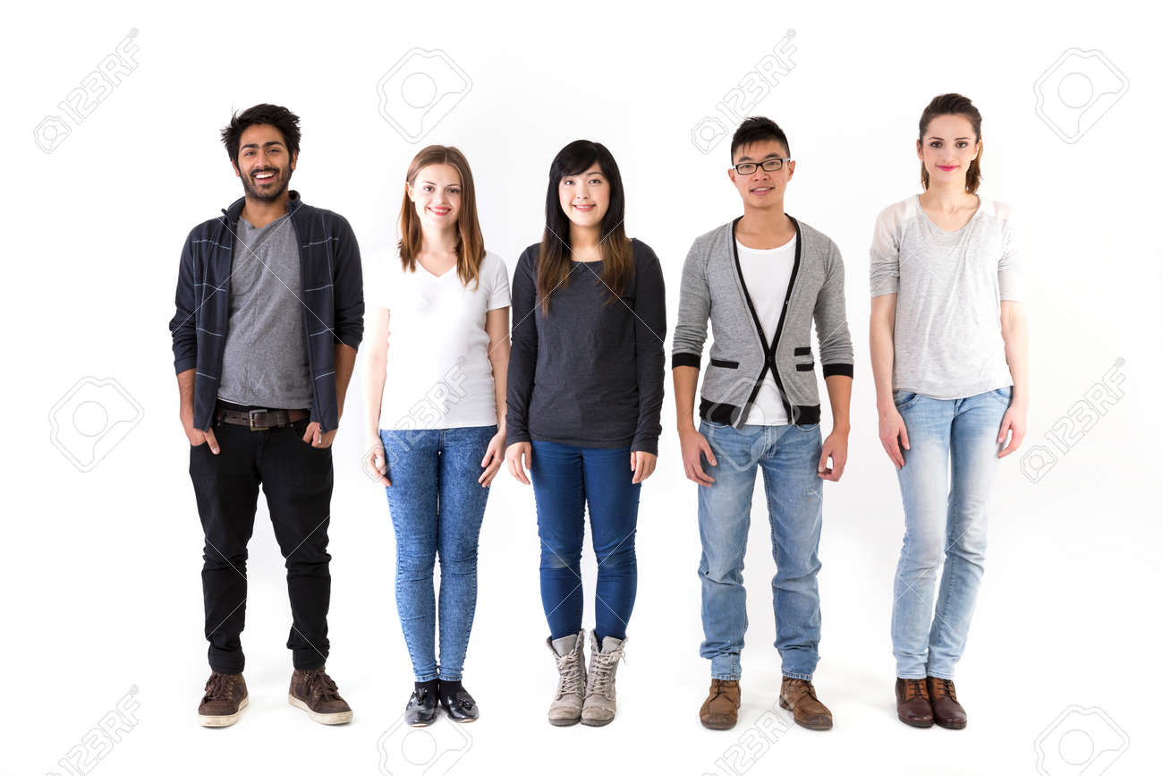 Happy group of friends standing in a row. Mixed race group. Isolated on a white background. Stock Photo - 37307506