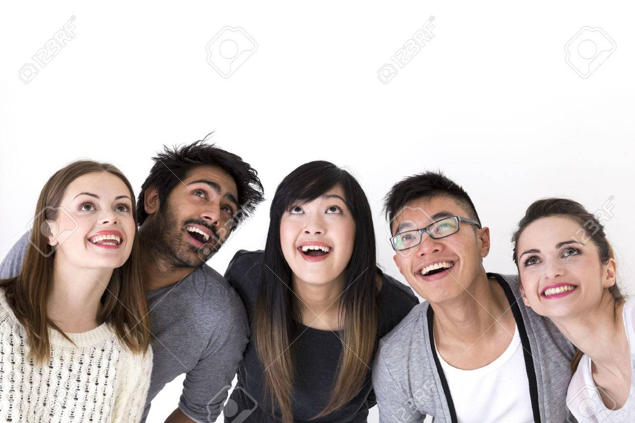 Happy group of friends looking up above them. Mixed race group. Isolated on a white background. Stock Photo - 37307527