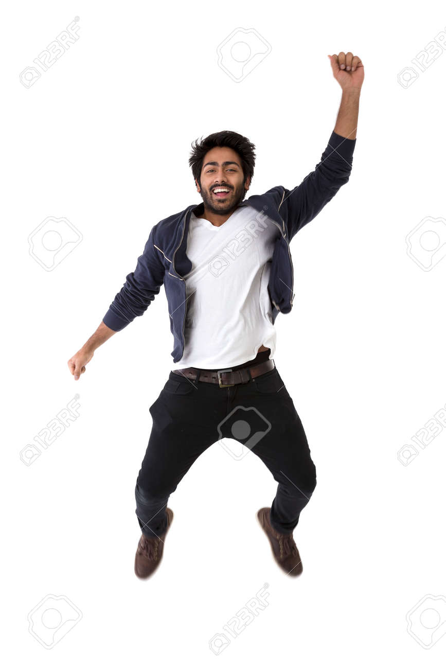 Excited Indian man jumping for joy. Isolated on white background. Stock Photo - 37309819