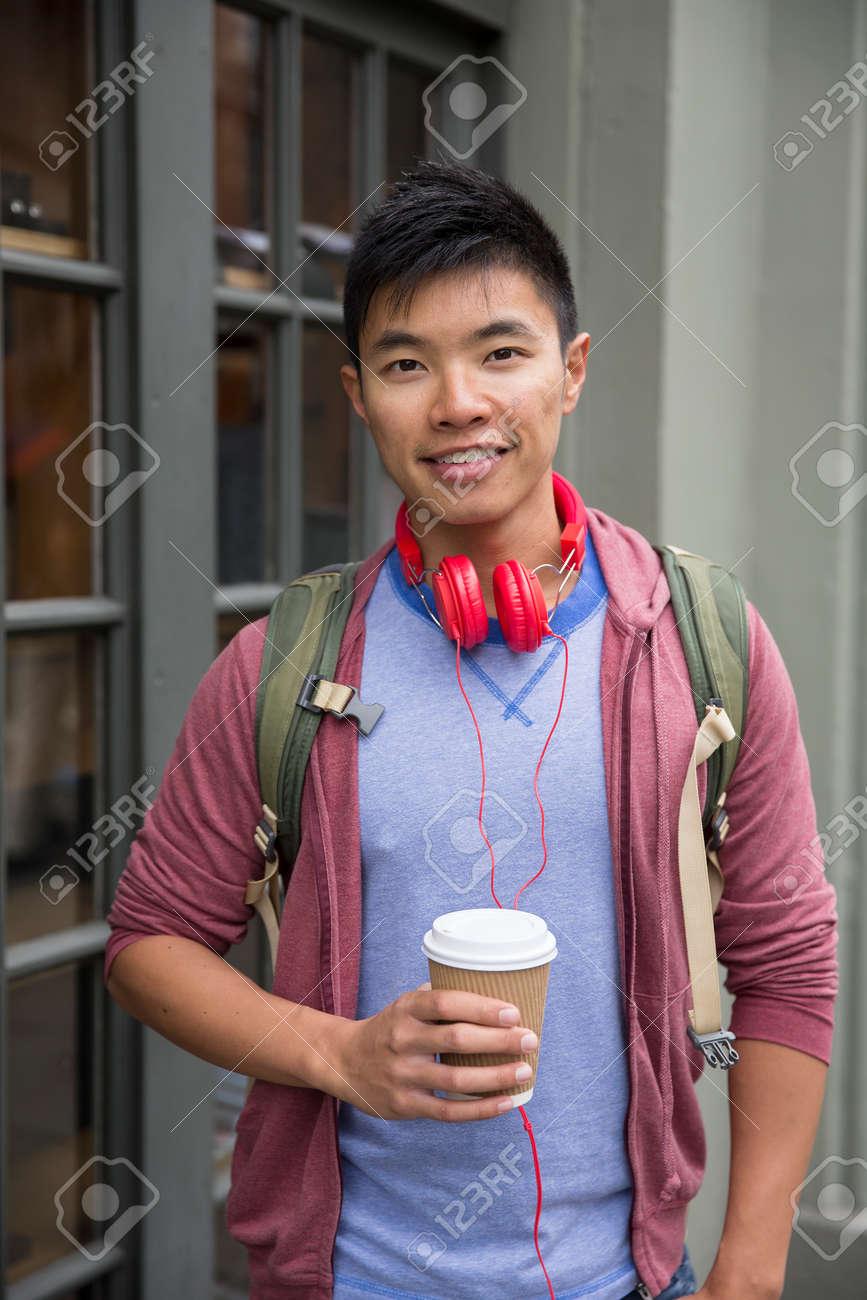 Portrait of a trendy urban Chinese man. Urban man in street. Stock Photo - 43406389
