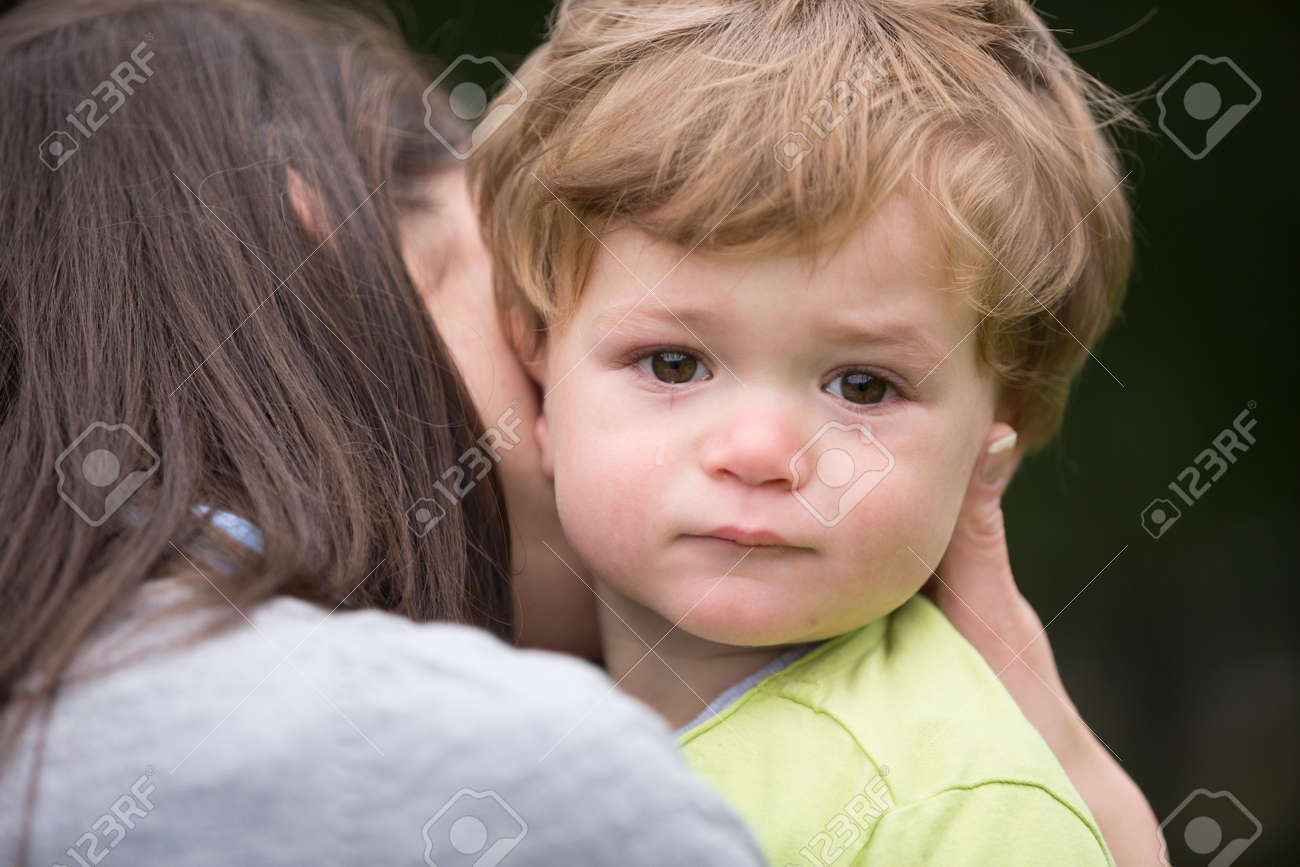 Sad little boy being hugged by his mother. Parenthood, Love and togetherness concept. - 57347157