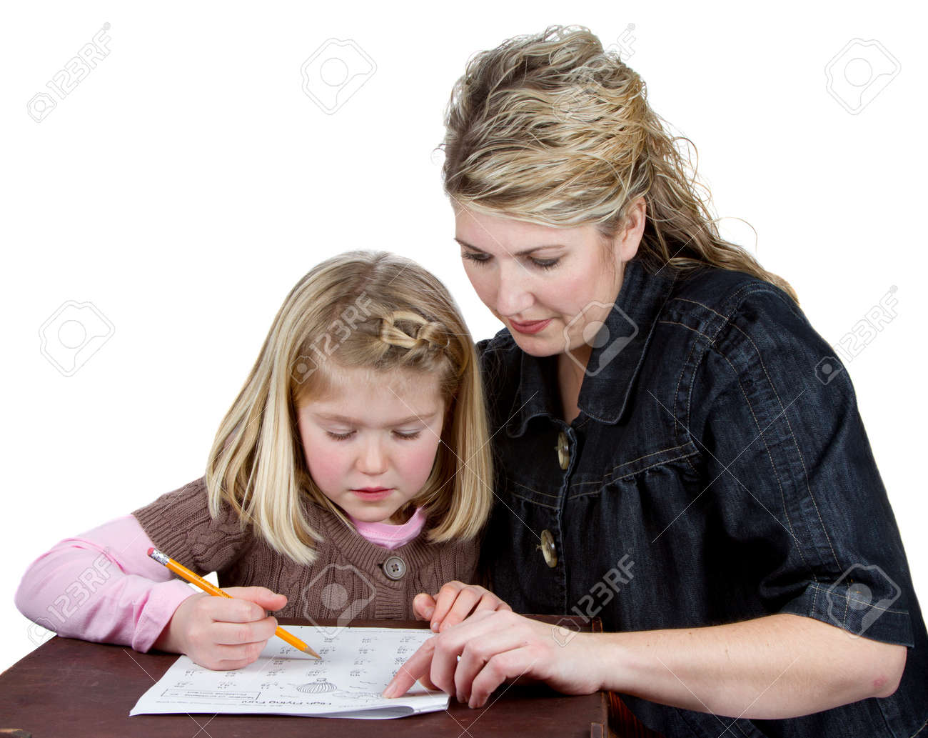 a teacher or maom helping a student or child homework stock photo a teacher or maom helping a student or child homework pointing at math homework while child works on problem isolated on a white