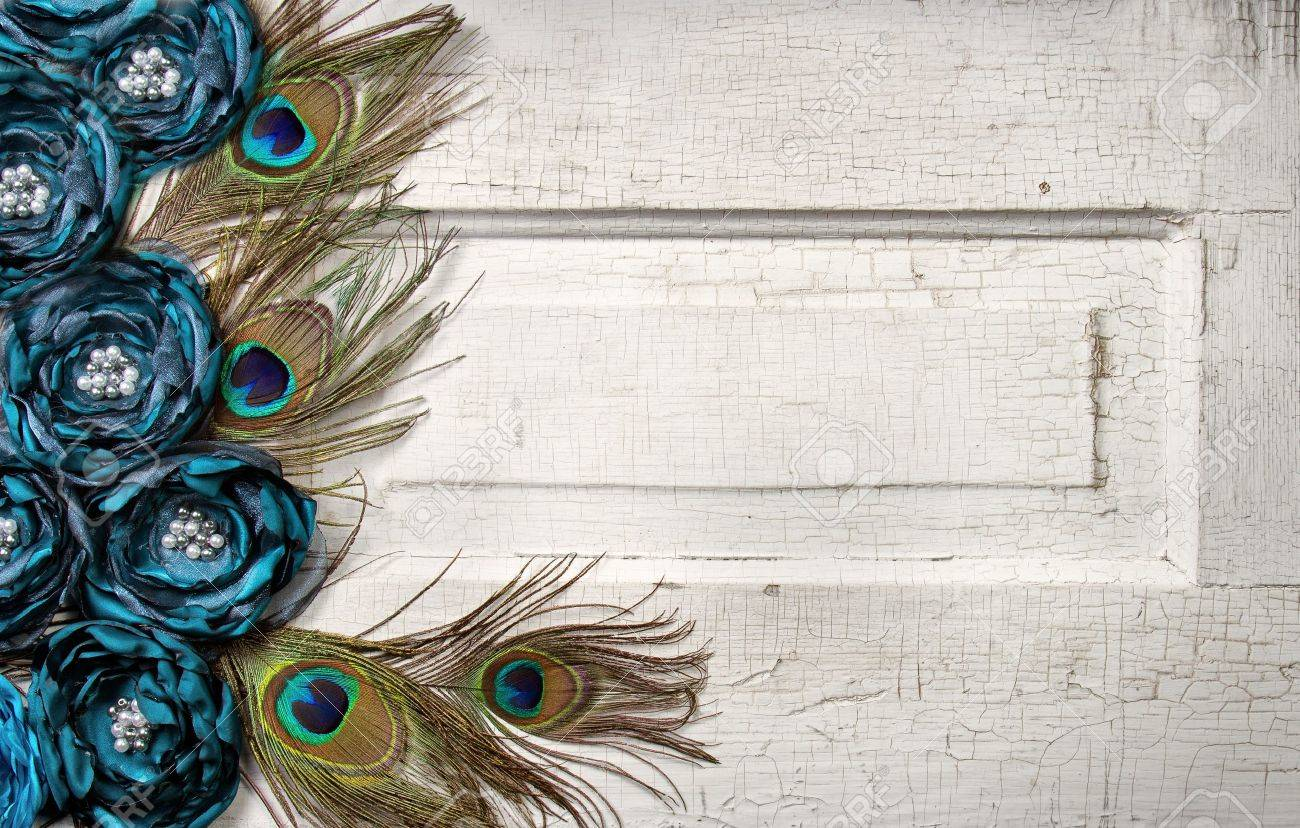 Peacock feathers and flowers on a white antique or vintage door for background Stock Photo - 13498226