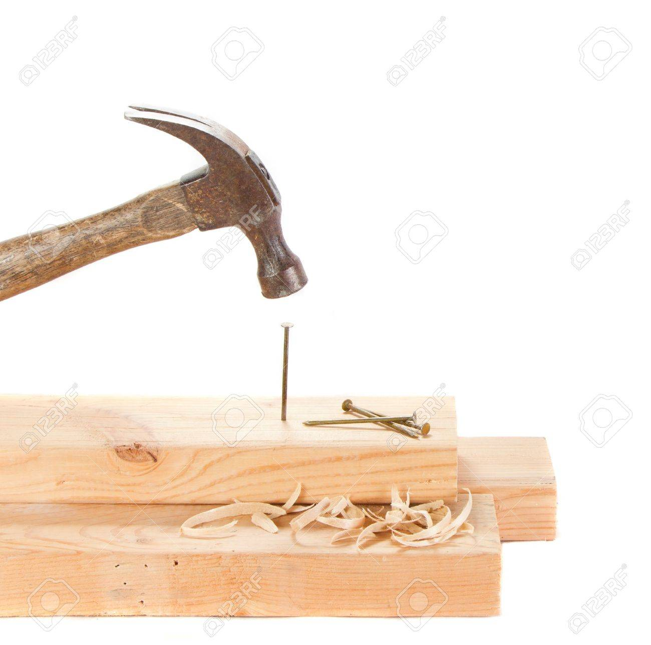 Stiking a nail with a hammer isolated on white background Stock Photo - 13497895