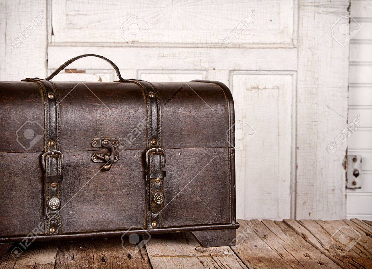 Wooden trunk or chest on an antique wooden backgrounds Stock Photo - 16758176
