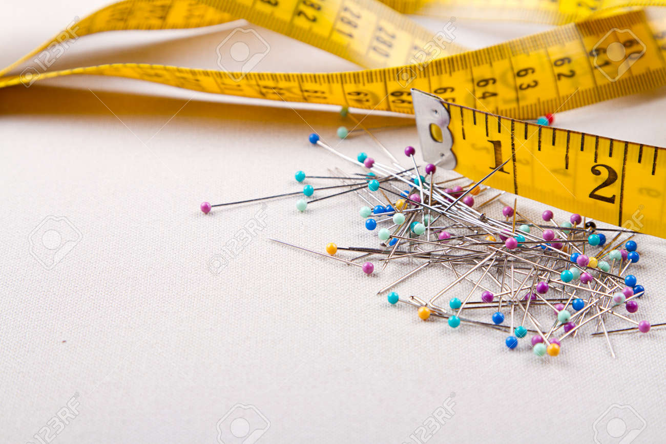 Sewing supplies, measuring tape, and  pins Stock Photo - 16758175