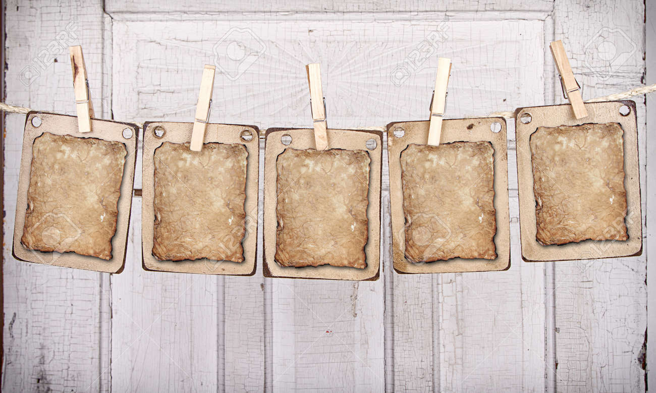 Aged wooden rectangles with aged paper on a clothes line ready for copy Stock Photo - 18723134