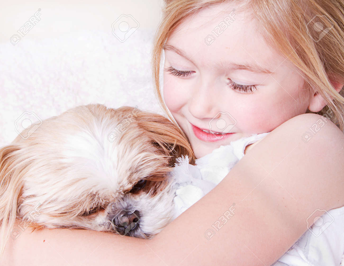 Young Girl Or Child Hugging A Shih Tzu Dog Stock Photo Picture And