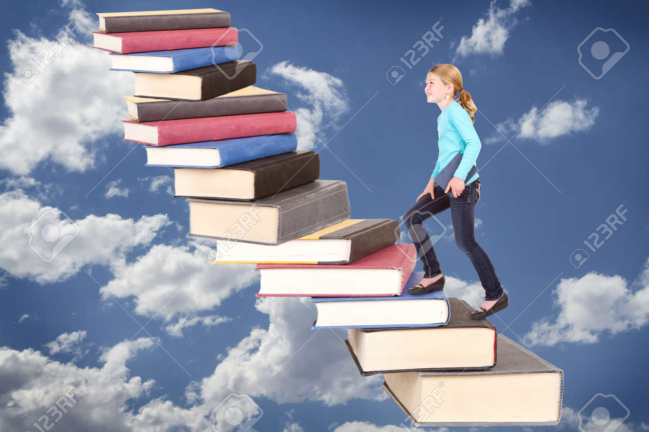 Child or girl climbing a staircase of books on cloudy sky background Stock Photo - 19989079