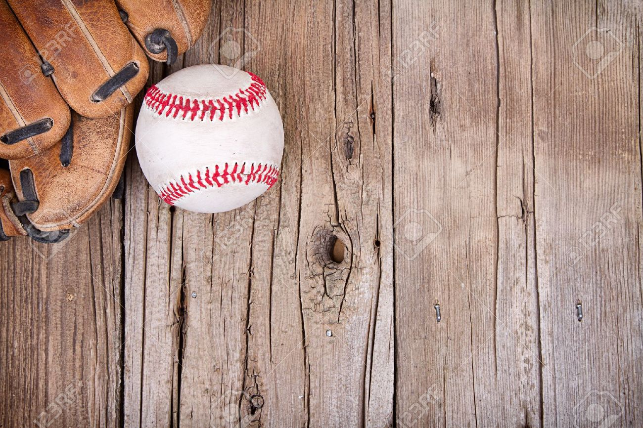 Baseball and mitt on rustic wooden background Stock Photo - 20984565