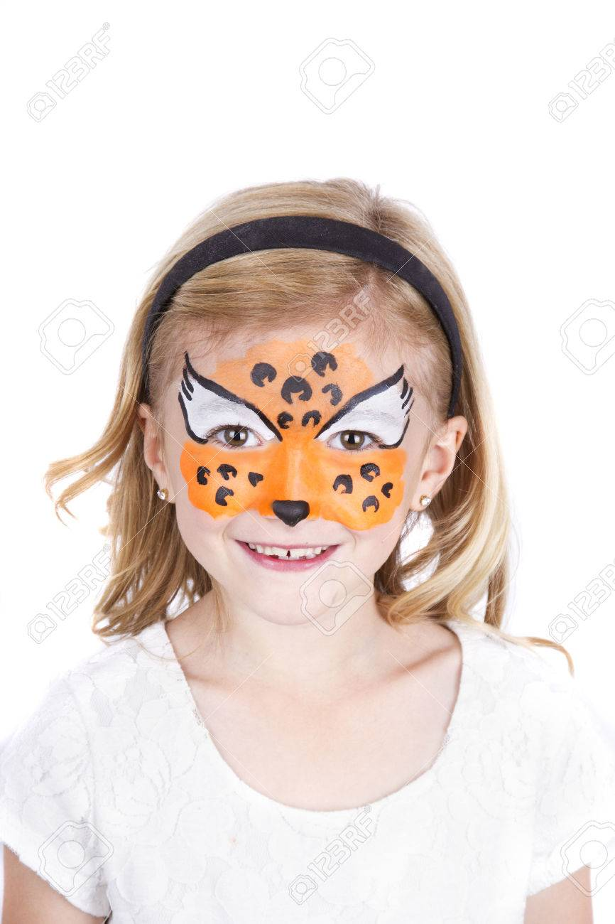 Young Girl Wearing Cheetah Carnival Face Paint Isolated On White