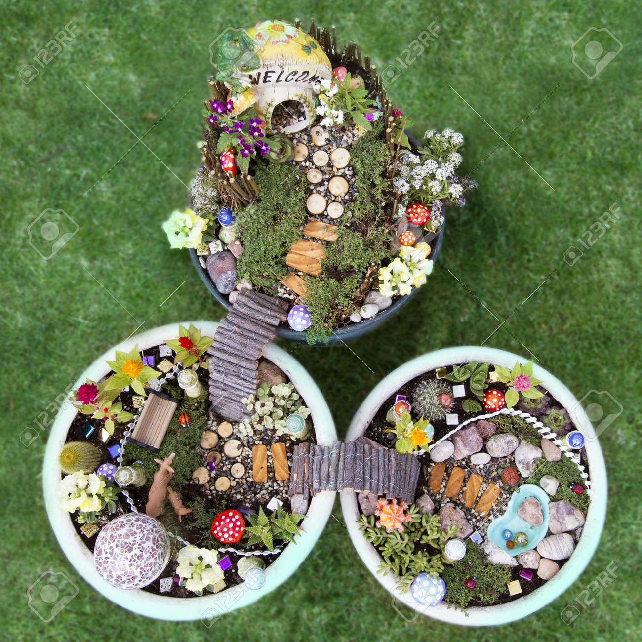 Birds Eye View Of Fairy Garden In A Flower Pot With Walking Path, Wooden  Bridges