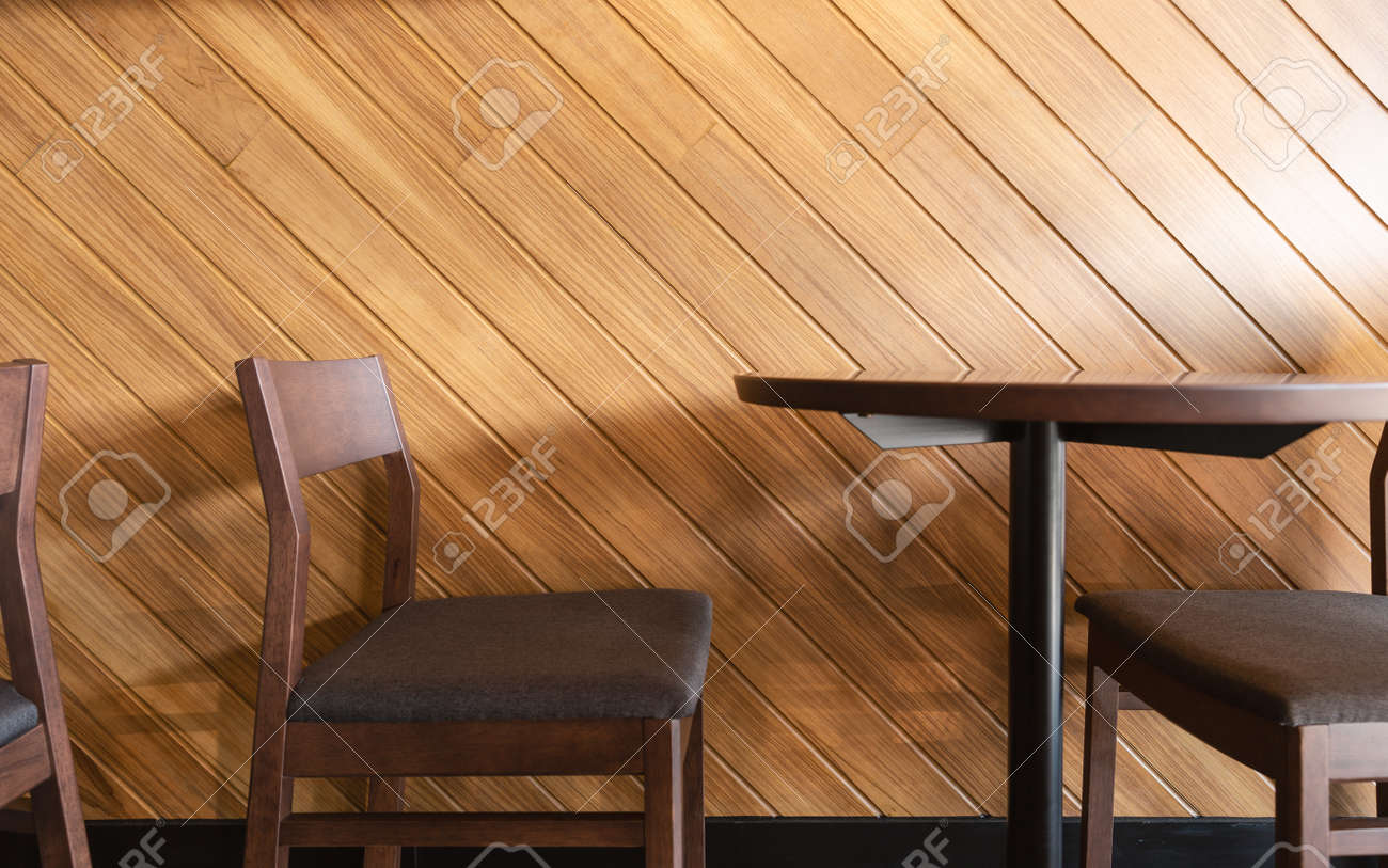 Wooden Chairs And Table Beside With Diagonal Line Of Laminate