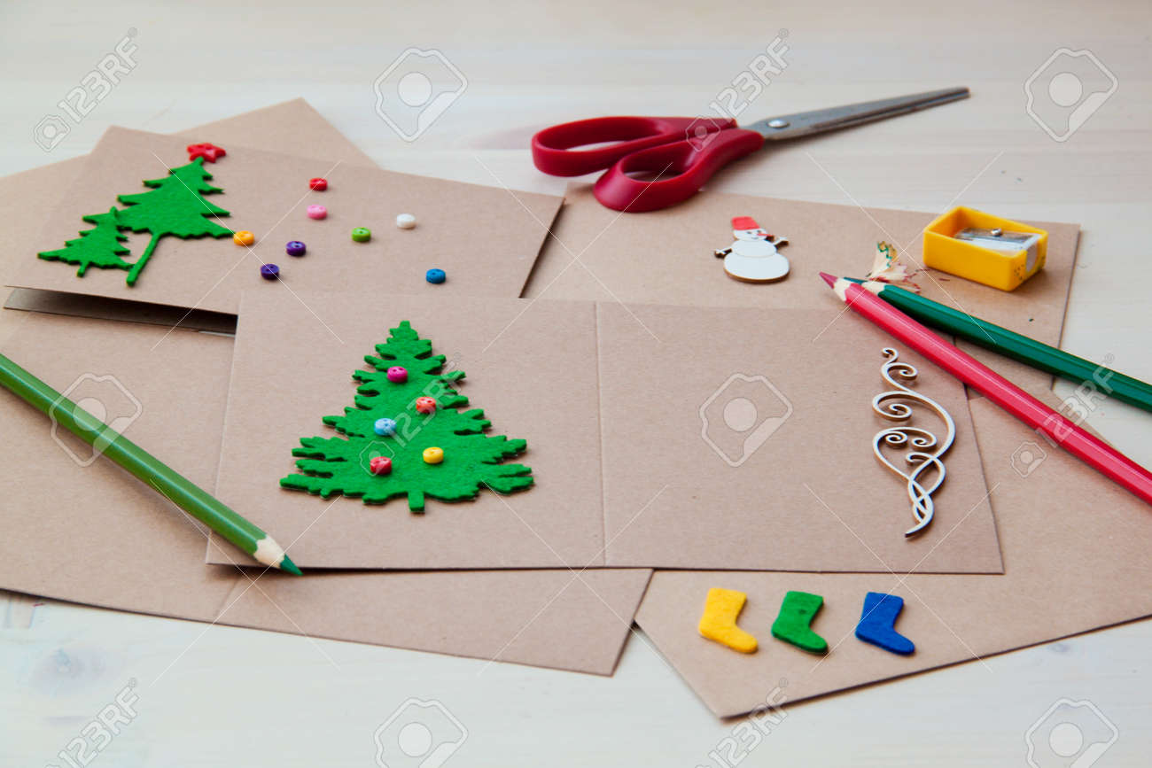 Signing Handmade Christmas Cards Felt Scissors Buttons Christmas