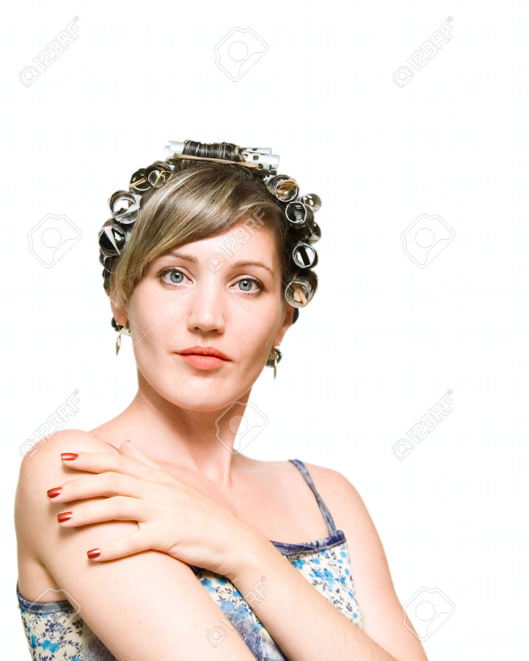 Young woman with haircurlers in her heir isolated on white Stock Photo - 5784989