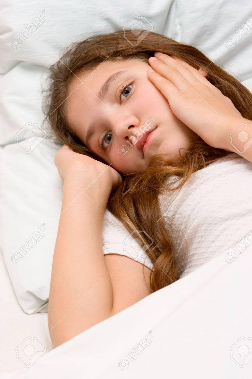 Portrait of cute teen girl in bed
