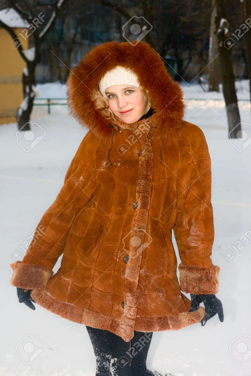Portrait Of Cute Teen Girl In Sheepskin Coat Stock Photo, Picture ...