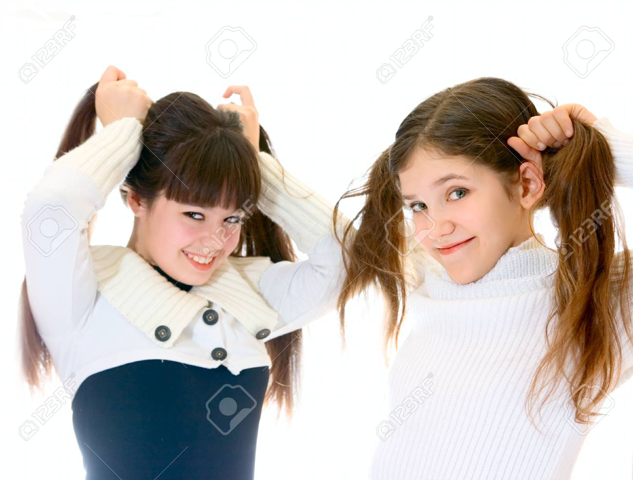 Two teen girls isolated on white Stock Photo - 6662152