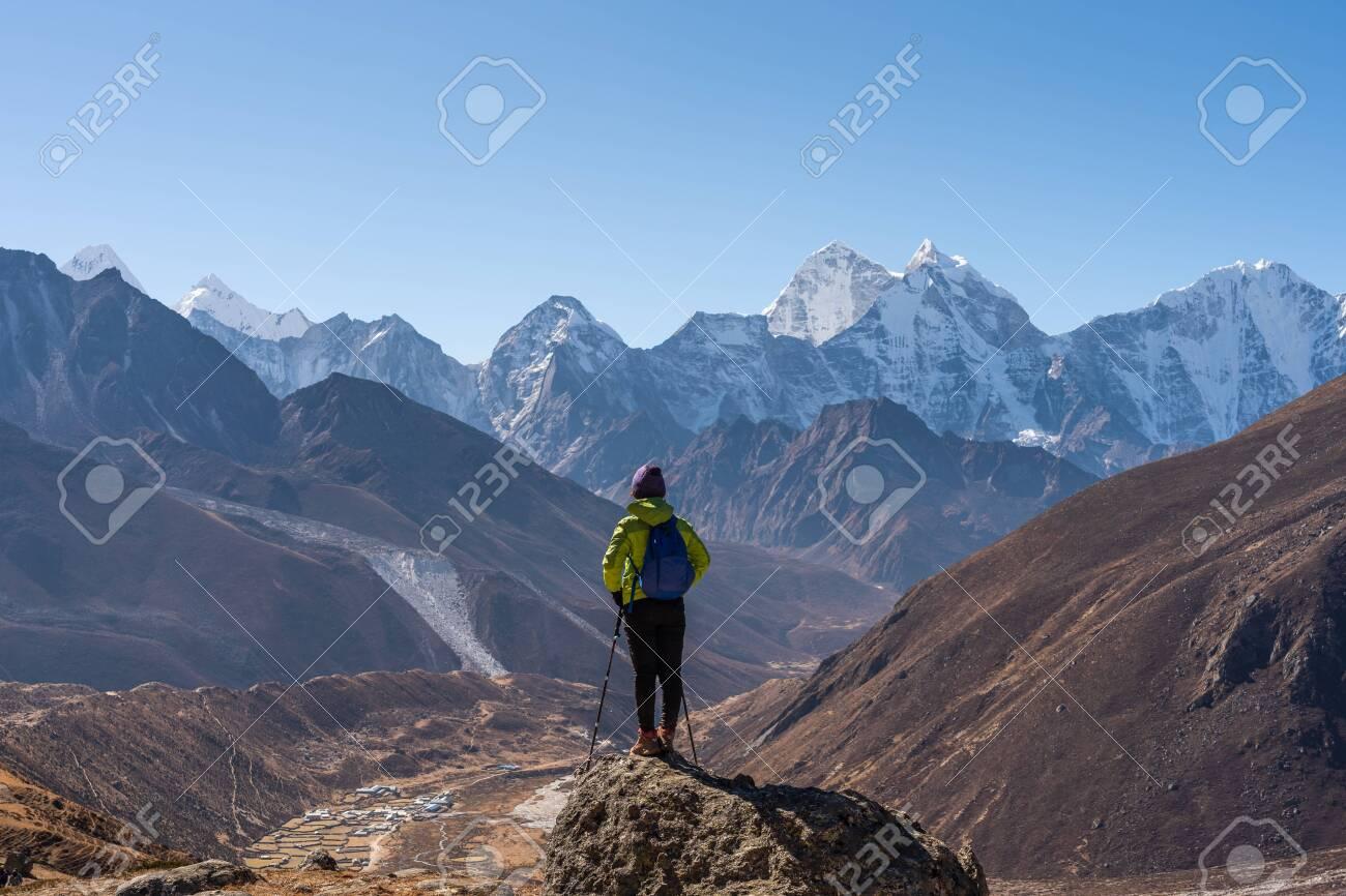 A trekker standing in front of Himalaya mountain range in Everest region, Nepal, Asia - 142566217