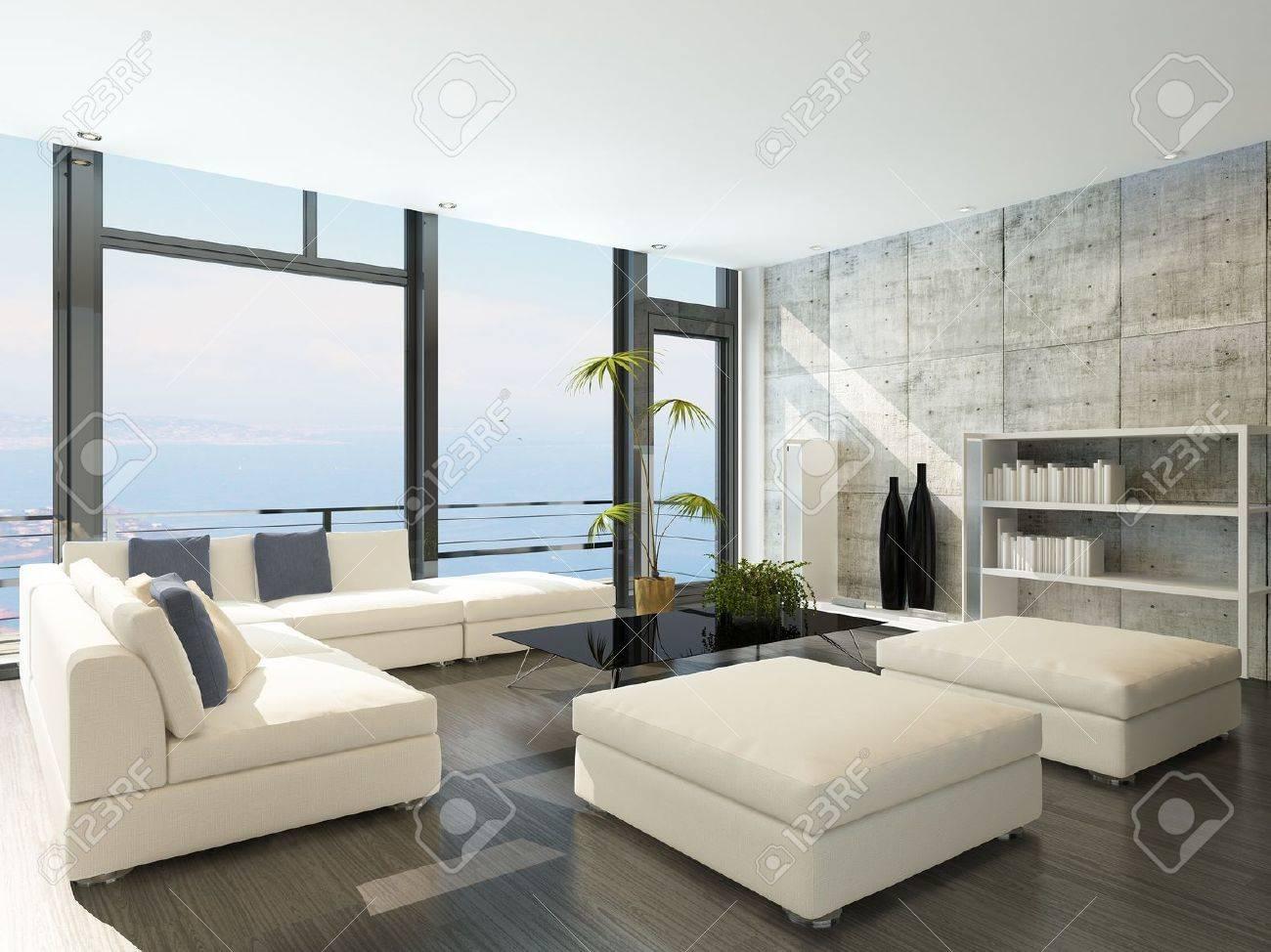 Moderne woonkamer met grote ramen en betonnen stenen muur royalty ...
