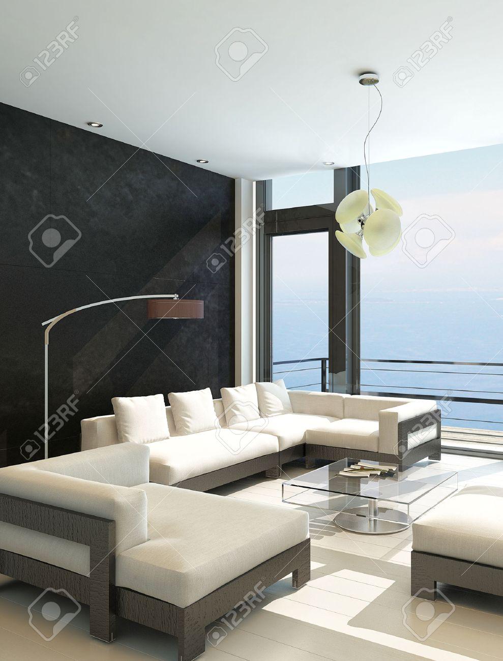 Moderne woonkamer met grote ramen en zwarte stenen muur royalty ...