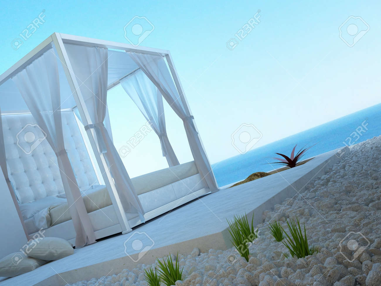 Outside Bed sunny patio with seascape view and outside bed stock photo