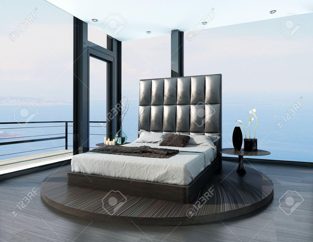 Design ultramoderne lit noir king-size dans une chambre ouverte avec de  grandes fenêtres