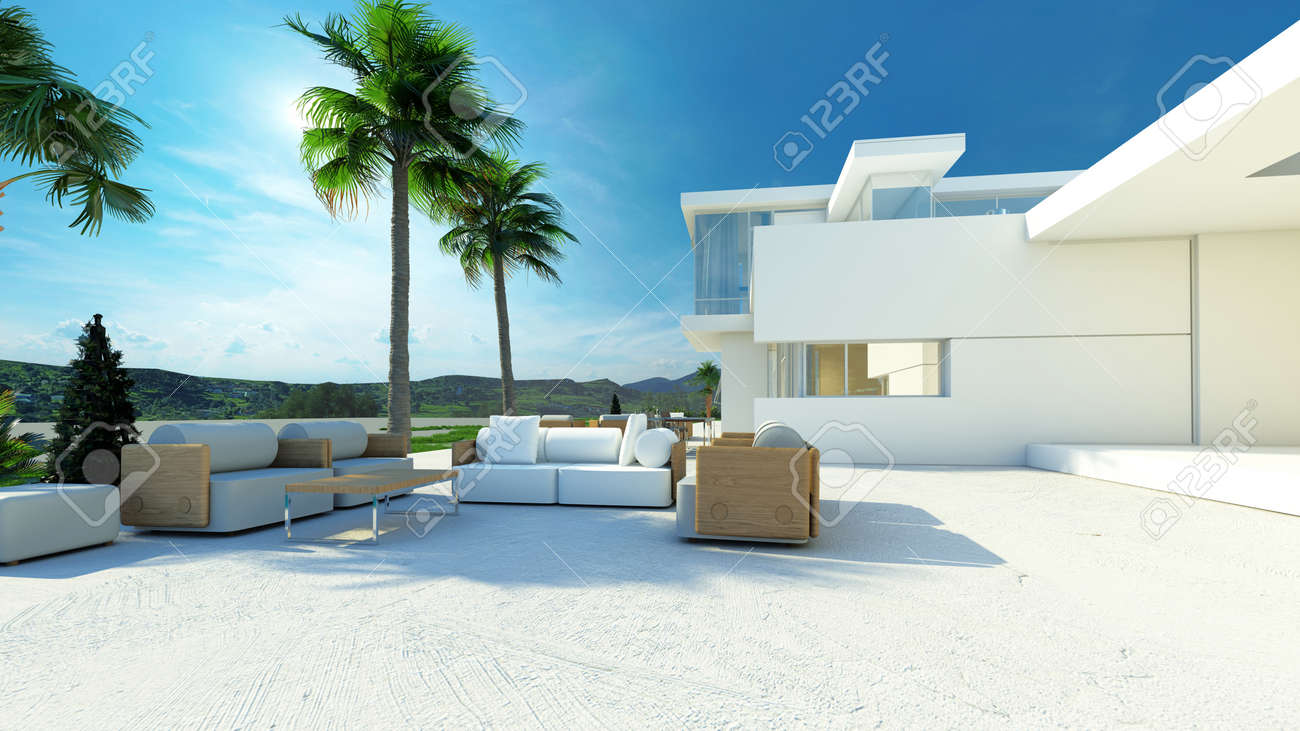 Outdoor Paved Patio Living Area With Comfortable Furniture In The Shade Of Palm  Trees In A
