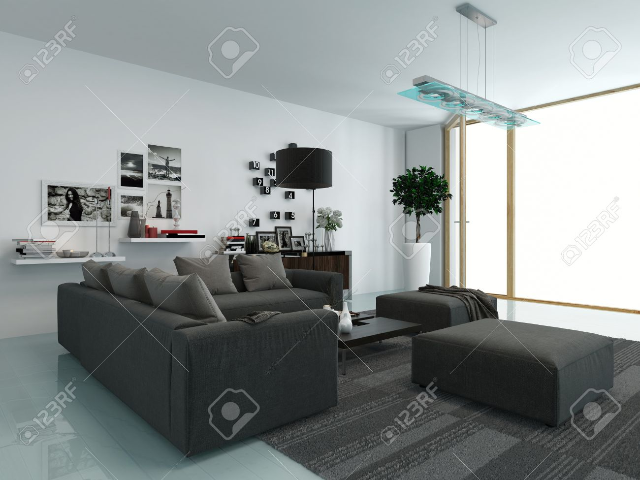 Modern Living Room With An Upholstered Lounge Suite Facing A View Window And Wall Mounted