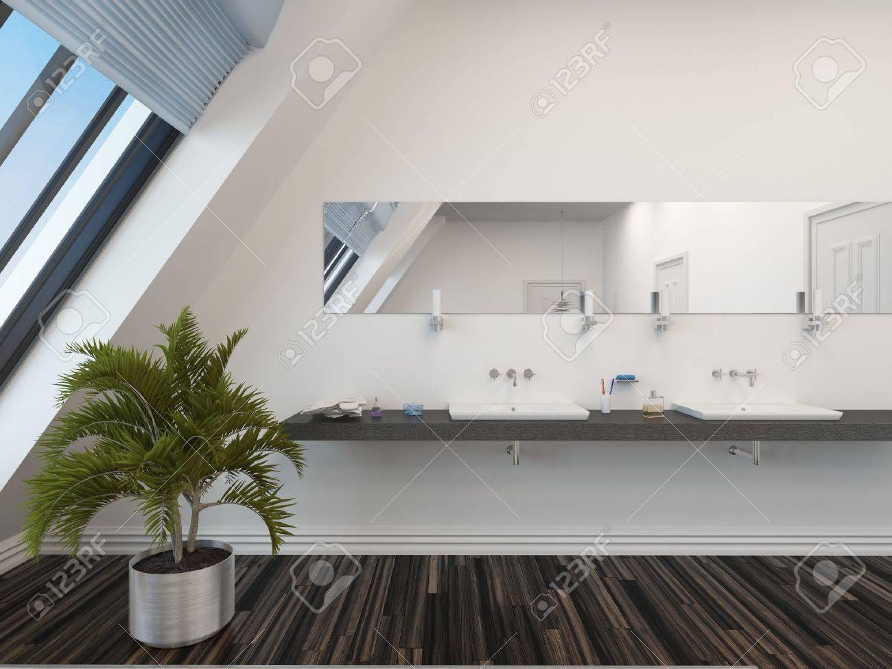 Salle de bains moderne avec une double vasque ci-dessous un long miroir  horizontal, mur blanc, fenêtres en pente et un palmier en pot sur un parquet