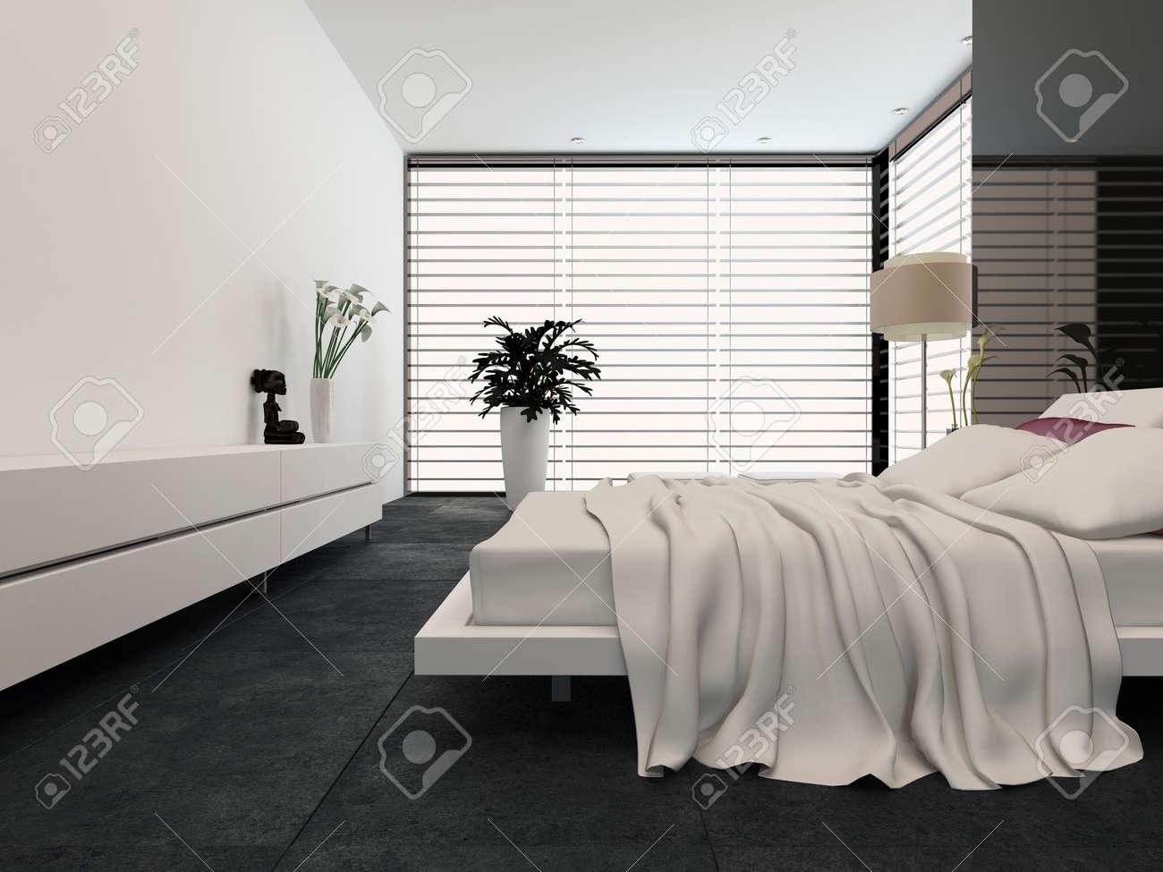 Moderna camera da letto spaziosa con un letto matrimoniale ...