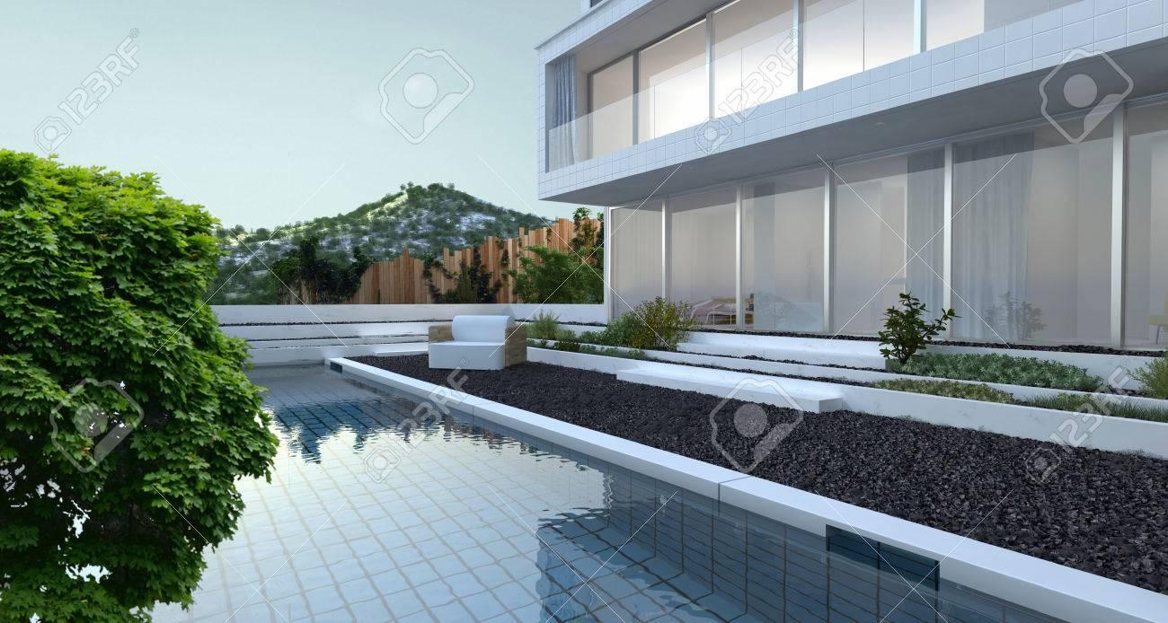 Maison moderne de luxe avec vue panoramique fenêtres de vue donnant sur un  patio mis à galets avec piscine et une crête de montagne en arrière-plan