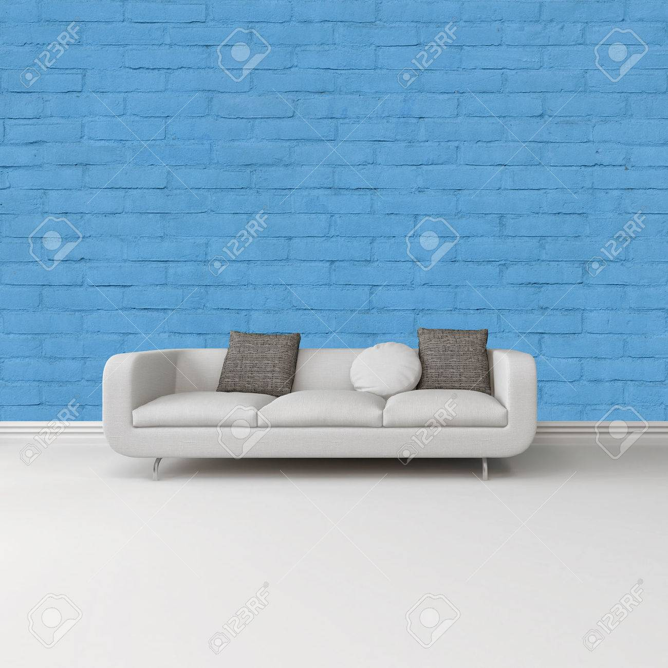 Modern White Sofa With Grey Cushions Against A Bright Blue Wall On A White  Floor With