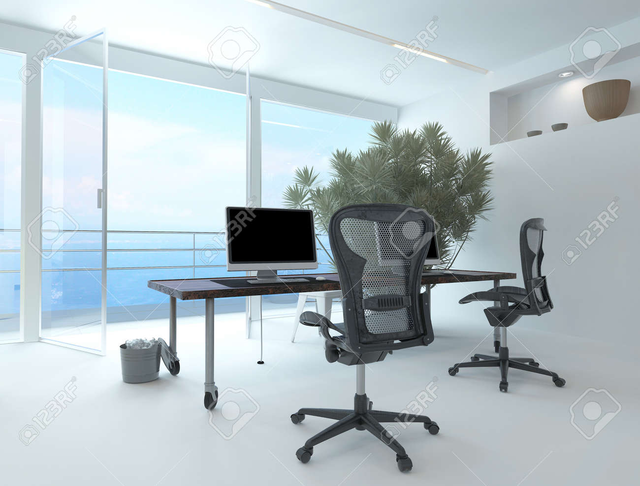 Modern Waterfront Office Interior With A Computer Workstation And Chairs In Front Of Large Floor