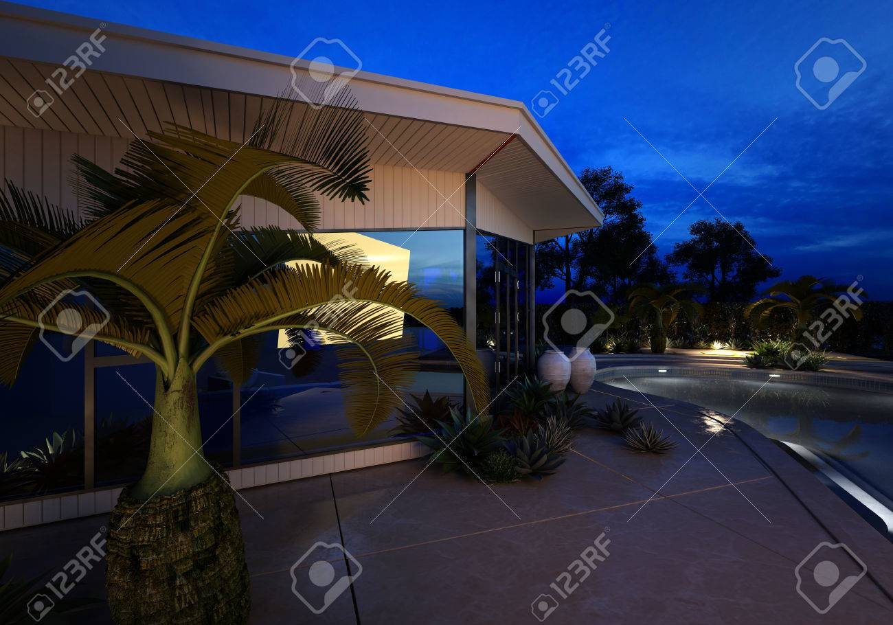High Quality Exterior Close Up View Of A Modern Design Luxury House With An Illuminated  Swimming Pool Surrounded