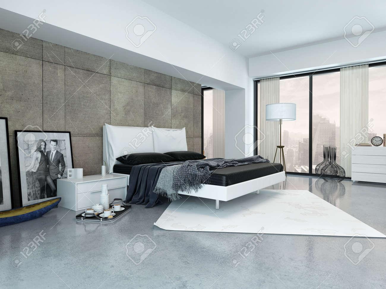 Moderna sovrum inredning med en dubbel divan säng, panelklädda ...