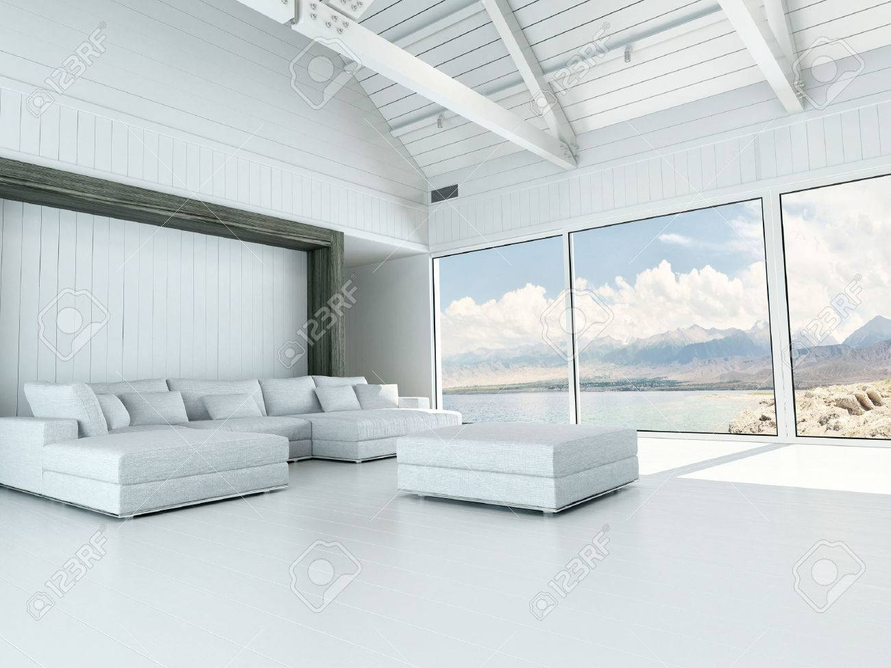 Intérieur moderne de salon blanche avec de grandes fenêtres avec vue  surplombant la côte et l\'océan et une suite unité de coin salon et d\'un  pouf ...