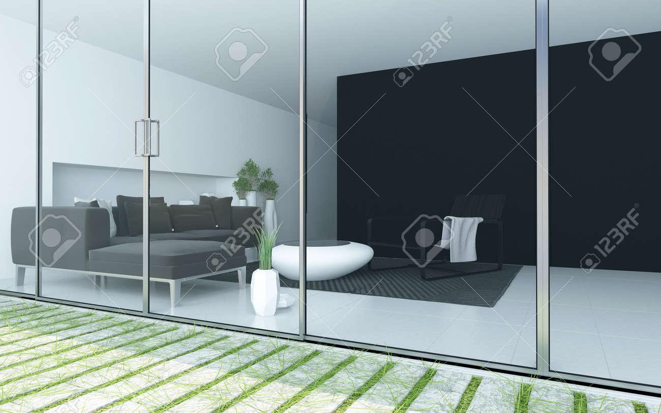 Modernt vardagsrum sett från en uteplats med ett golv till tak ...