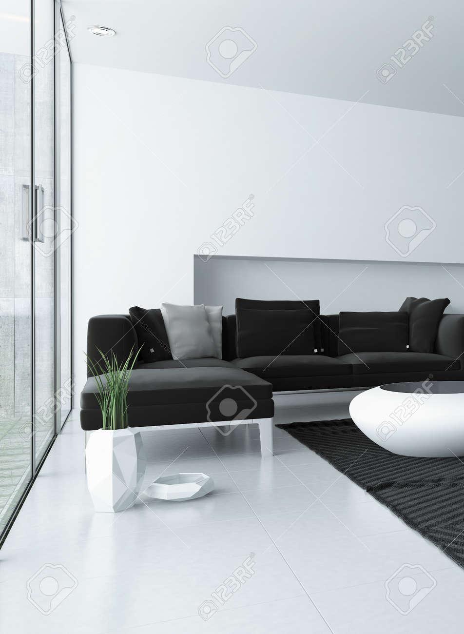 Salon moderne avec un décor gris et blanc et une suite de salon unité de  coin rembourré en face de grandes fenêtres et de la porte menant à un ...
