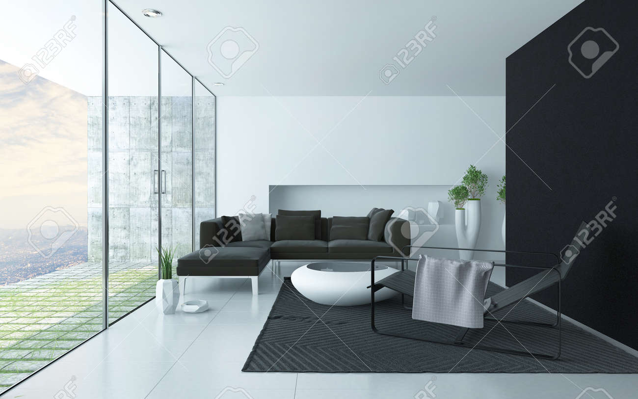 Charcoal Grey And White Modern Living Room Interior With A Glass Wall Overlooking Paved Patio