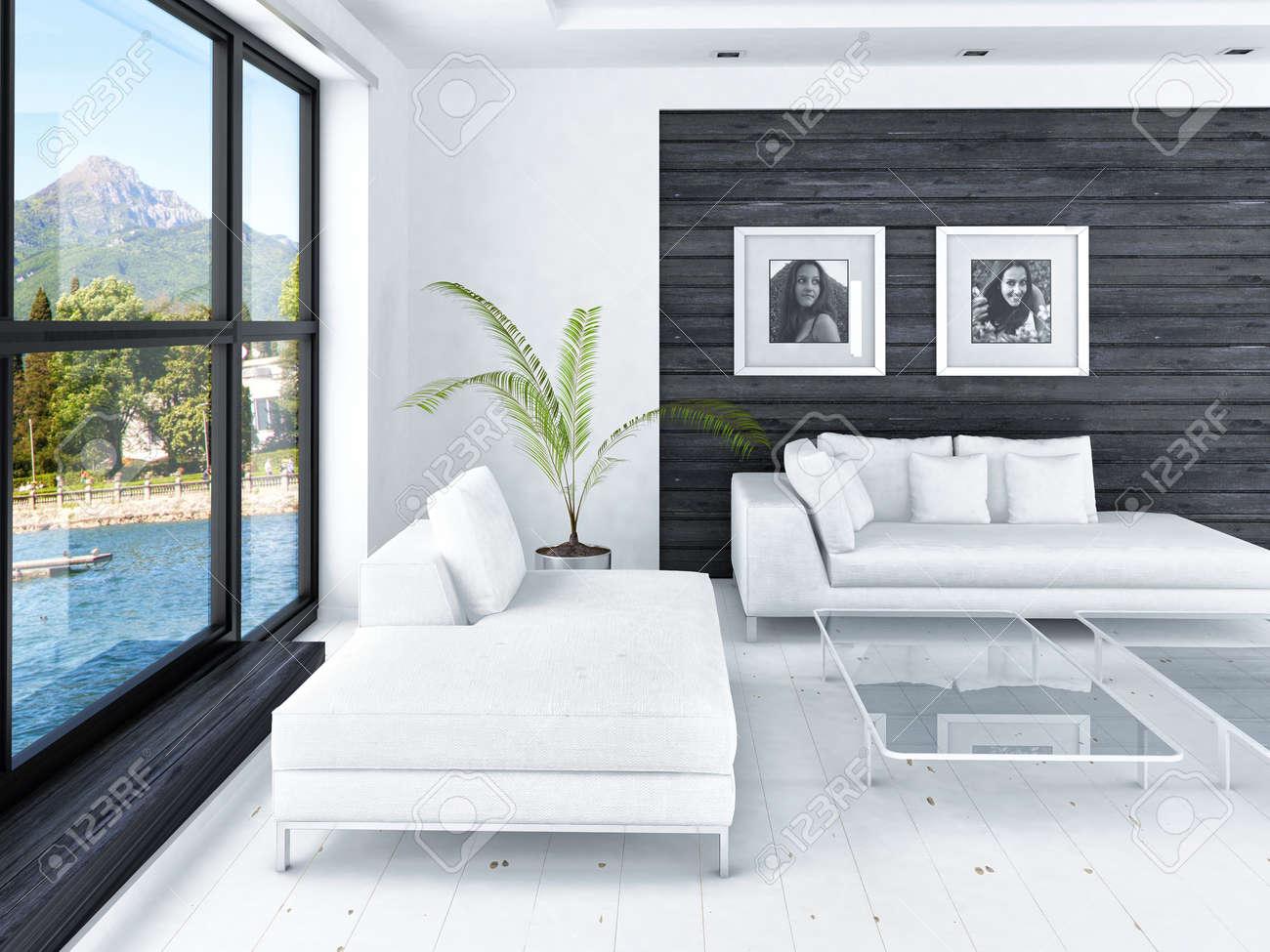 Moderne woonkamer met grote ramen en zwarte houten wand royalty ...