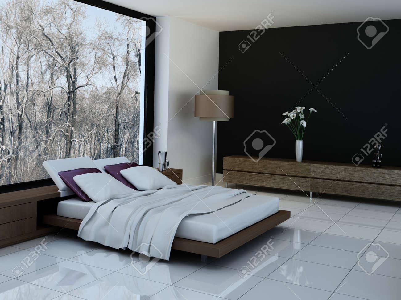 Intérieur de la chambre ultramoderne avec un lit double contre fenêtres  panoramiques