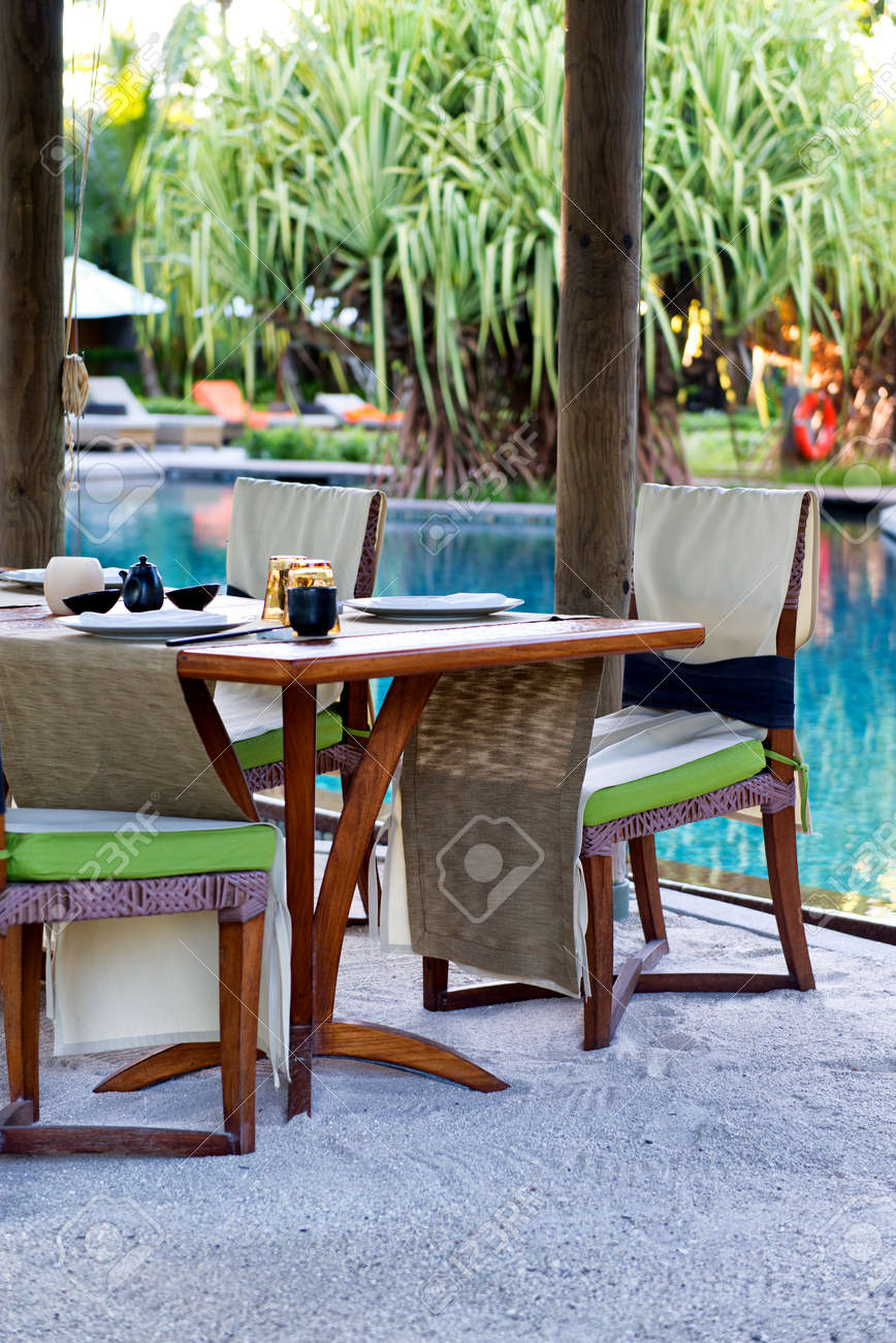 Beau Poolside Table With Place Settings At Outdoor Asian Restaurant Stock Photo    33430305