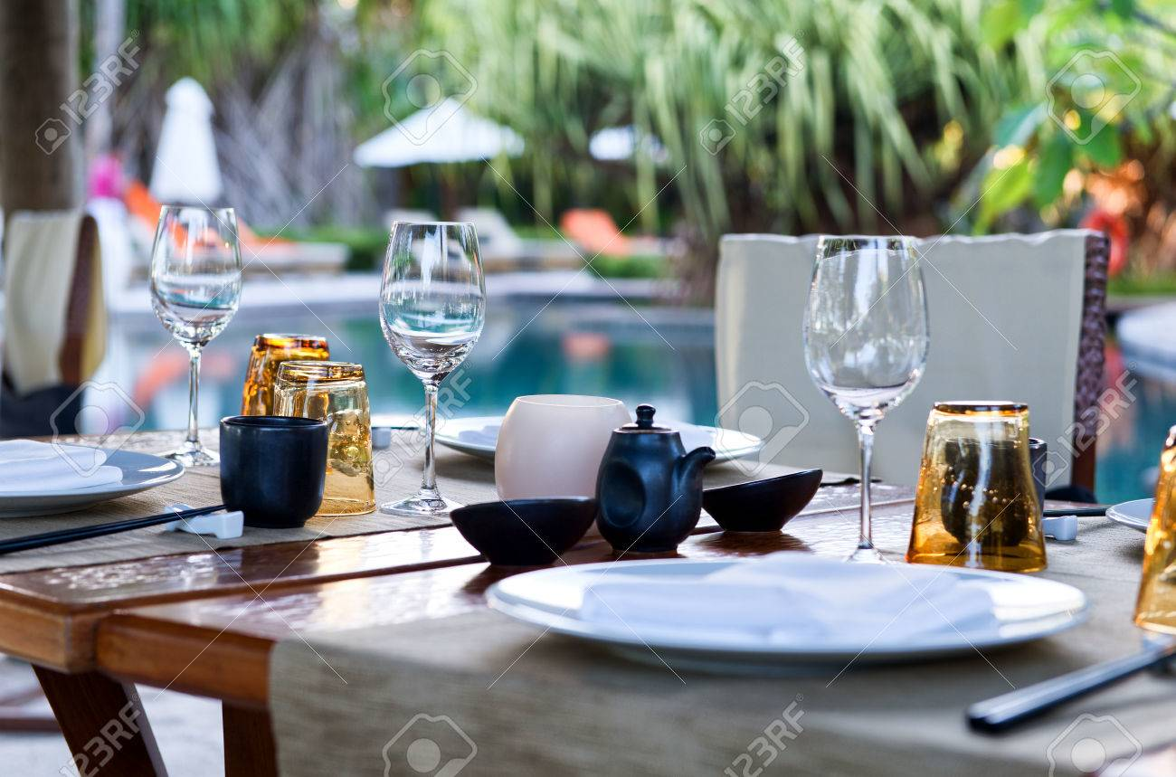 Close Up Of Table Place Settings At Outdoor Poolside Asian Restaurant Stock  Photo   33430310