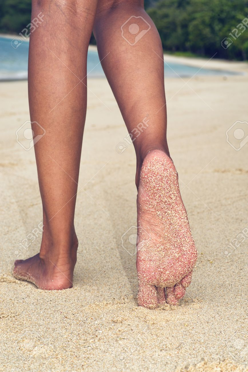 low angle close up view of the feet and legs of an asian woman