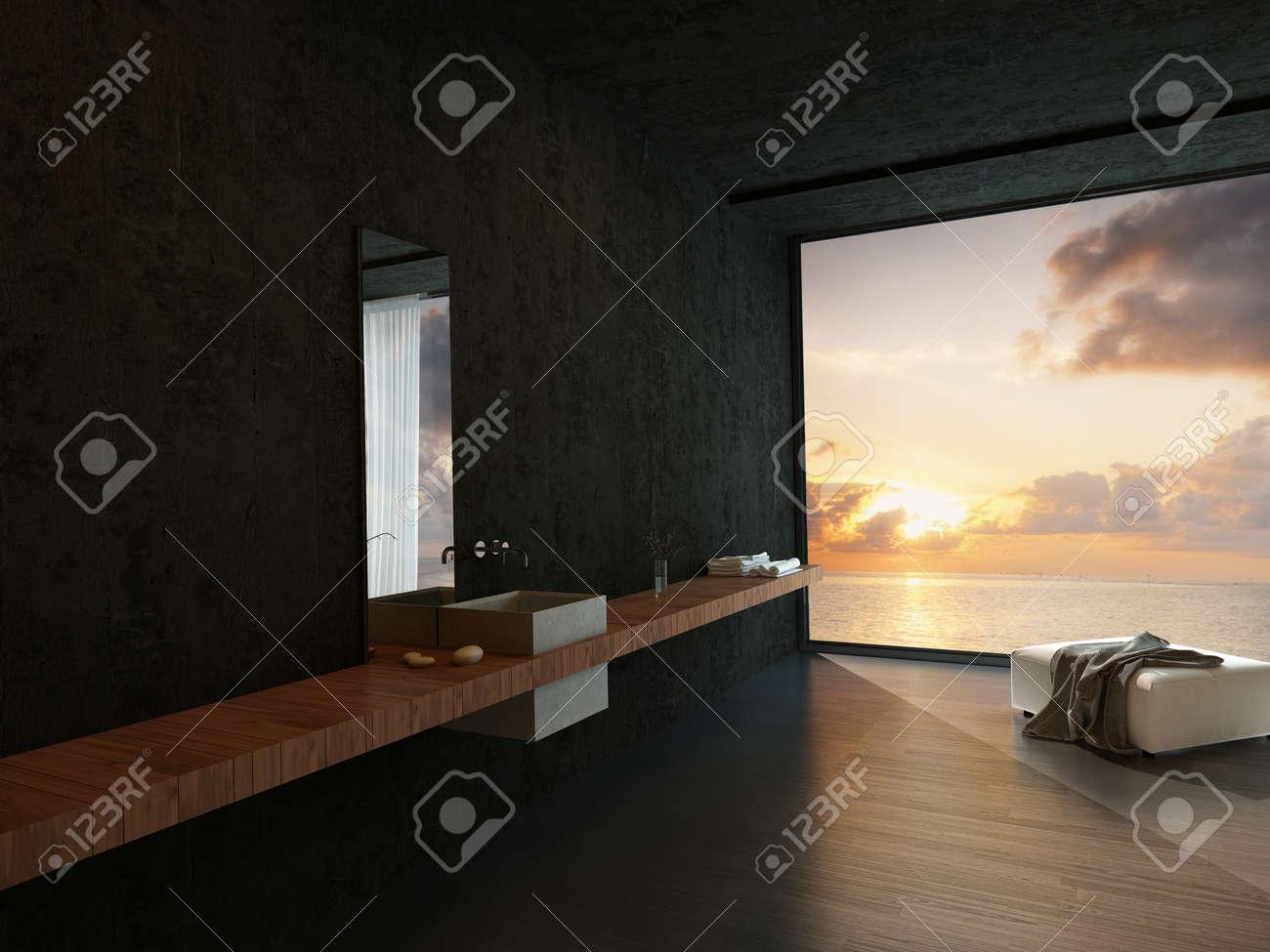 Intérieur de salle de bains moderne avec une vanité mural, pouf et une  orange de vue coloré océan coucher de soleil dans une propriété de bord de  mer ...