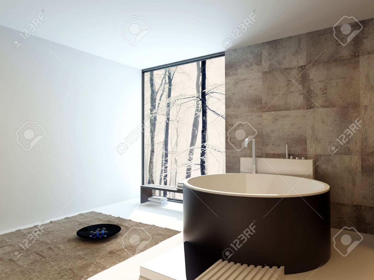 Design contemporain salle de bains de luxe intérieur avec une baignoire  autoportante ronde brune contre un mur en travertin beige carrelé avec une  ...