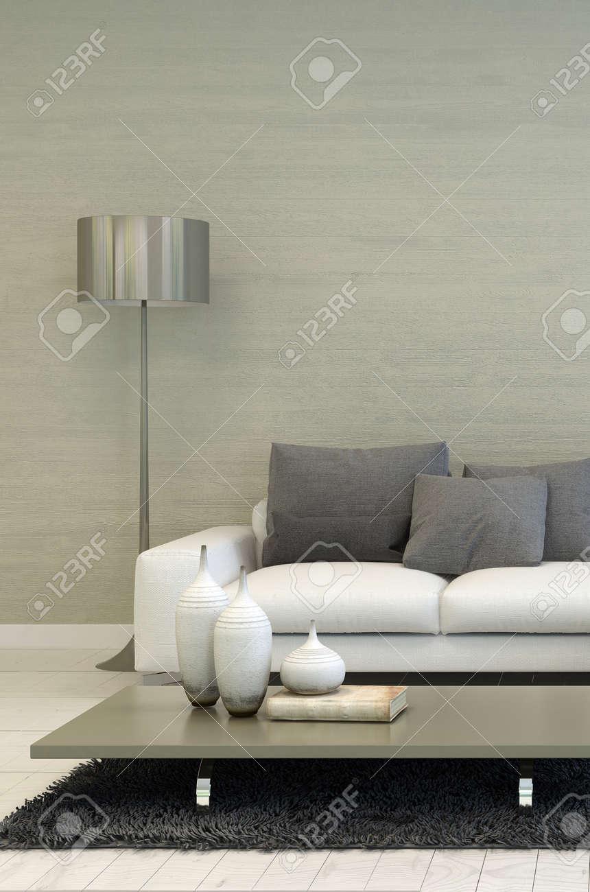 Detalj av modernt vardagsrum med metal golvlampa, vit soffa och ...